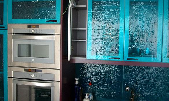 Modern kitchen with designer glass front